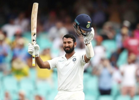 Super century by Pujara