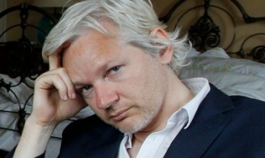 Assange under arrest, faces multiple charges