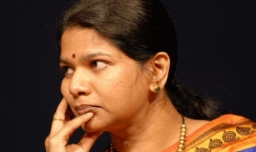 Why  Kanimozhi house was raided?